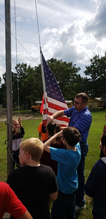 5th grade will now raise and lower the Elementary flags.