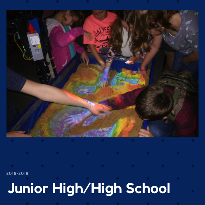 7th grade students in STEM class learn about topography with the augmented reality sandbox built by the high school Concepts of Engineering Class!