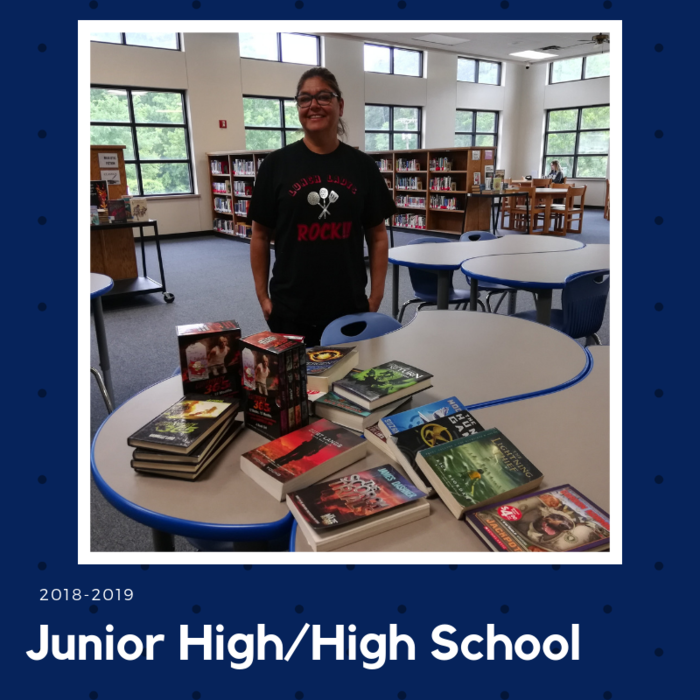 Ms. Martha with books she donated to the JH/HS Book Drive.
