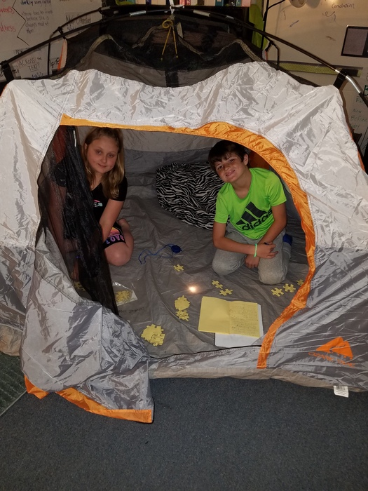 Evey and King writing in the tent.